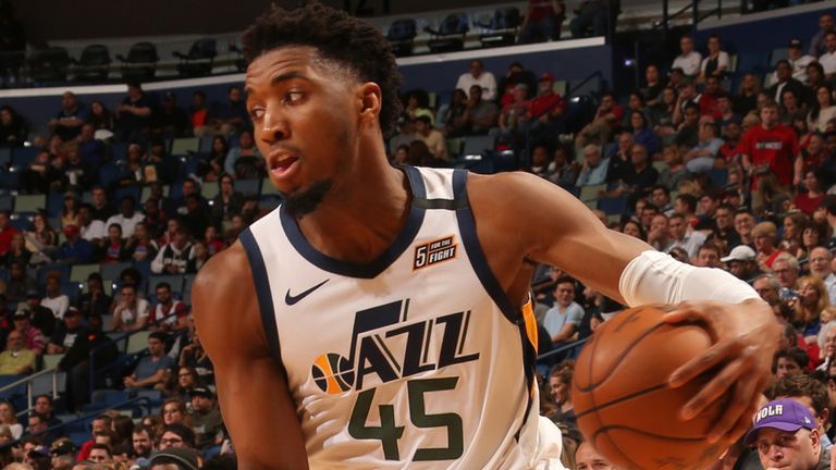 Donovan Mitchell looks to beat his defender off the dribble