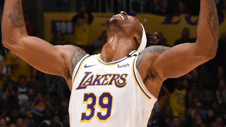 Dwight Howard celebrates a defensive play during the Lakers' win over the Pistons