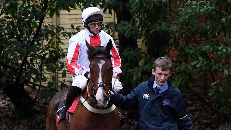 Goshen ridden by Jamie Moore heads out to the track at Sandown