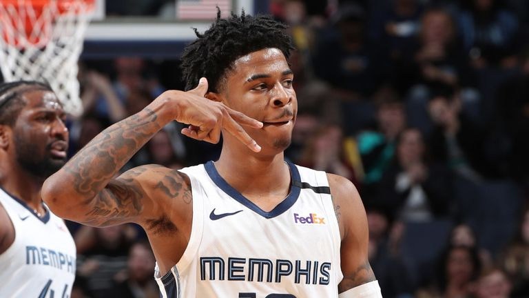Ja Morant celebrates a successful three-pointer in Memphis' win against Minnesota