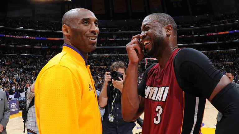 Kobe Bryant and Dwyane Wade share a word before a Lakers-Heat game