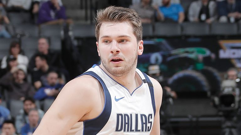Luka Doncic controls possession against the Kings