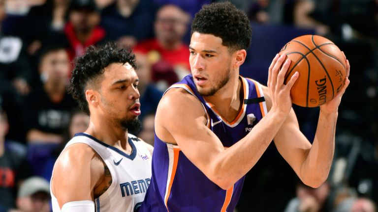 Devin Booker works in the post against Memphis