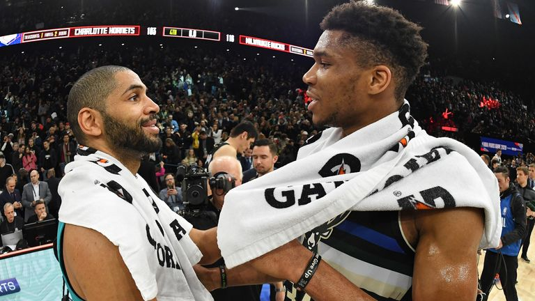 Nicolas Batum and Giannis Antetokounmpo embrace at the conclusion of the NBA Paris Game