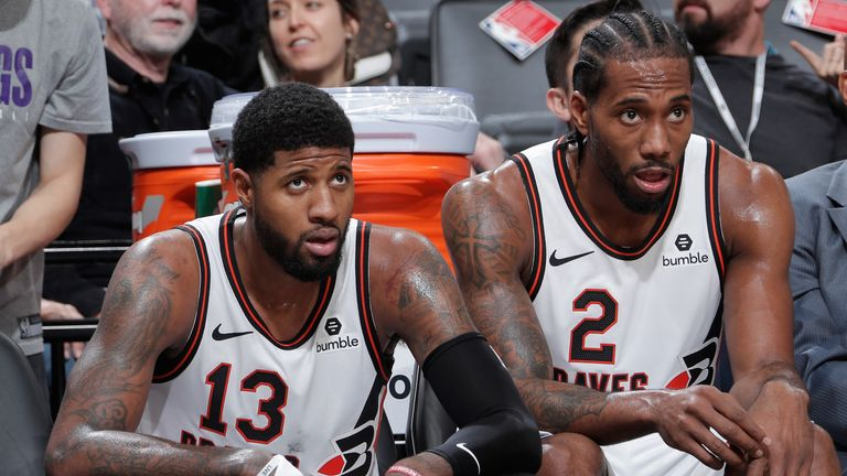 Paul George and Kawhi Leonard pictured on the bench during the Clippers' win over the Kings