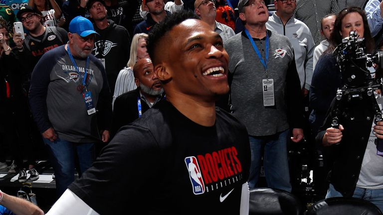 Russell Westbrook smiles as he watches a video tribute prior to Houston's game at Oklahoma City