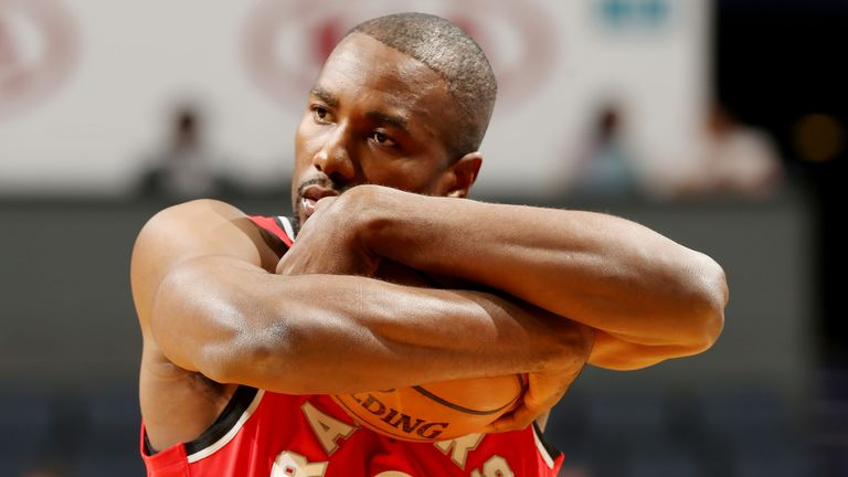 Serge Ibaka protects the ball in the Raptors' overtime win over the Hornets