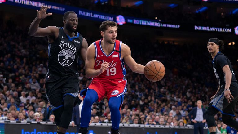 Raul Neto #19 of the Philadelphia 76ers dribbles the ball against Draymond Green #23 of the Golden State Warriors in the second quarter at the Wells Fargo Center on January 28, 2020 in Philadelphia, Pennsylvania.