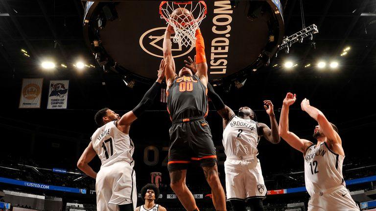 Aaron Gordon of the Orlando Magic dunks the ball against the Brooklyn Nets