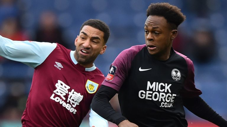 Ricky Jade-Jones of Peterborough United battles for possession with Aaron Lennon of Burnley during the FA Cup Third Round match at Turf Moor