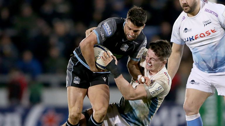 Glasgow's Adam Hastings is tackled by Tom Curry of Sale