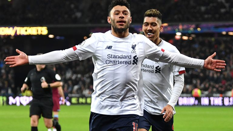 Alex Oxlade-Chamberlain celebrates after putting Liverpool 2-0 up at West Ham