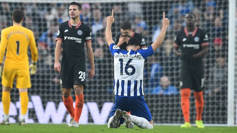 Alireza Jahanbakhsh drops to his knees at full time after his goal secures a point for Brighton at home to Chelsea