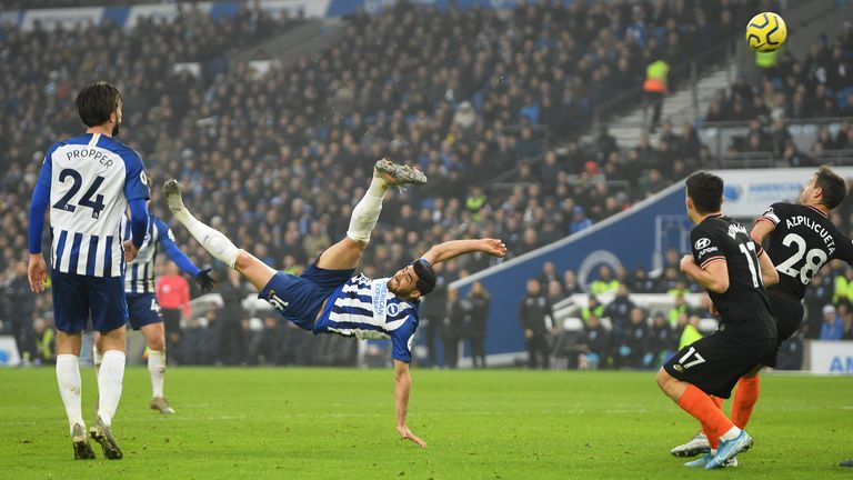Alireza Jahanbakhsh twists in the air during his acrobatic equaliser for Brighton against Chelsea