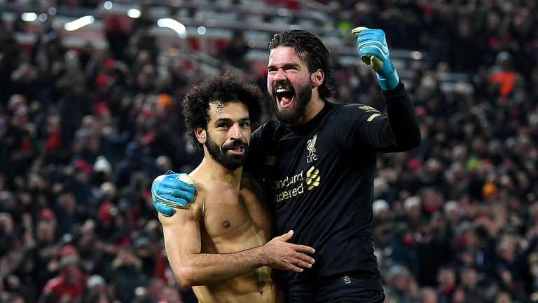 Alisson Becker and Mohamed Salah of Liverpool celebrate victory after the Premier League match between Liverpool FC and Manchester United at Anfield on January 19, 2020 in Liverpool, United Kingdom