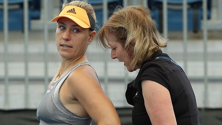 Kerber received treatment on her back during her match against Dayana Yastremska but was unable to continue