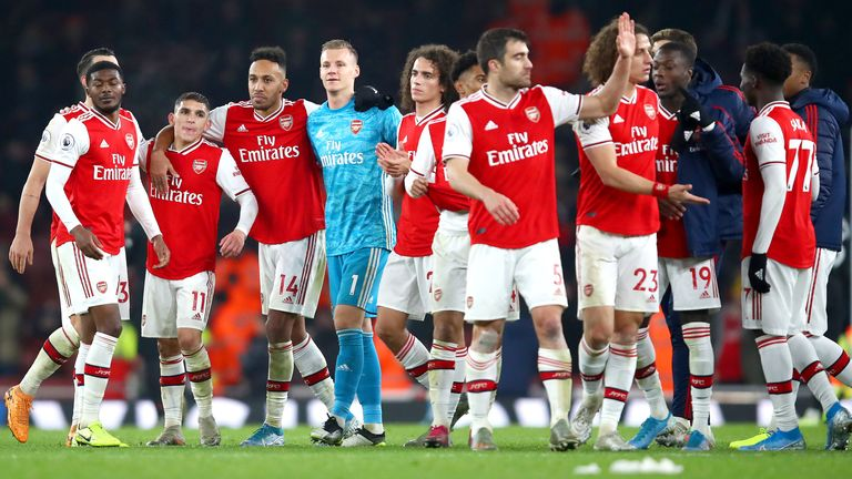 Arsenal players celebrate their win over Manchester United