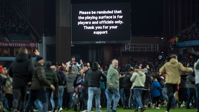 Aston Villa urged their supporters to leave the pitch after the final whistle