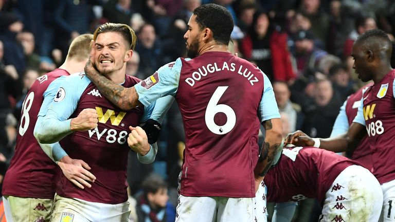 Villa players celebrate their last-gasp win over Watford