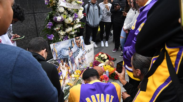 Flowers and tributes are left at a makeshift memorial for former NBA player Kobe Bryant outside the 62nd Annual GRAMMY Awards at STAPLES Center on January 26, 2020
