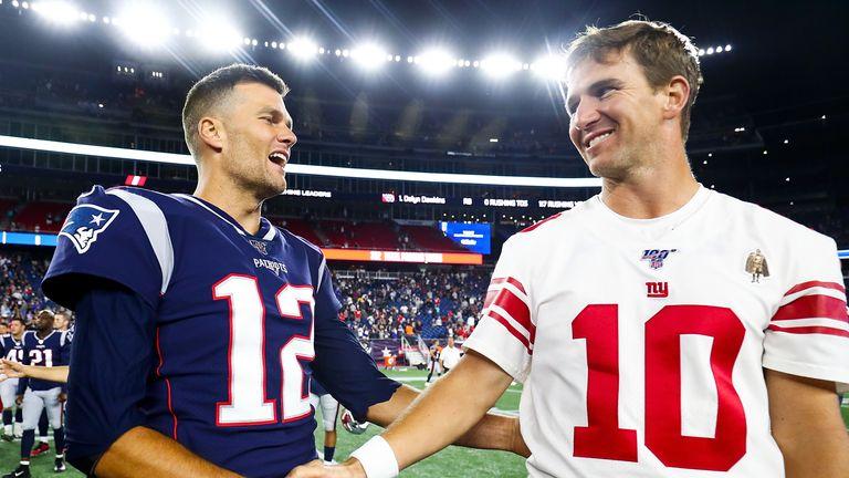 New York Giants quarterback Eli Manning with Tom Brady