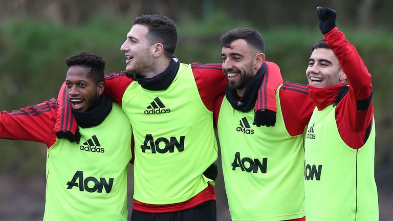 Bruno Fernandes with Manchester United team-mates, Fred, Diogo Dalot and Andreas Pereira during his first training session at Carrington