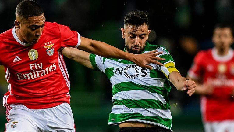 Benfica's Brazilian forward Carlos Vinicius (L) vies with Sporting's Portuguese midfielder Bruno Fernandes
