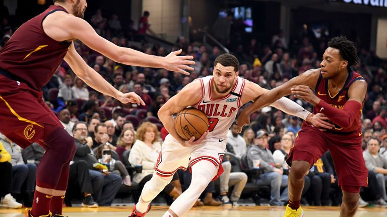 Zach LaVine #8 of the Chicago Bulls drives past Kevin Love #0 and Darius Garland #10 of the Cleveland Cavaliers during the first half at Rocket Mortgage Fieldhouse on January 25, 2020 in Cleveland, Ohio.