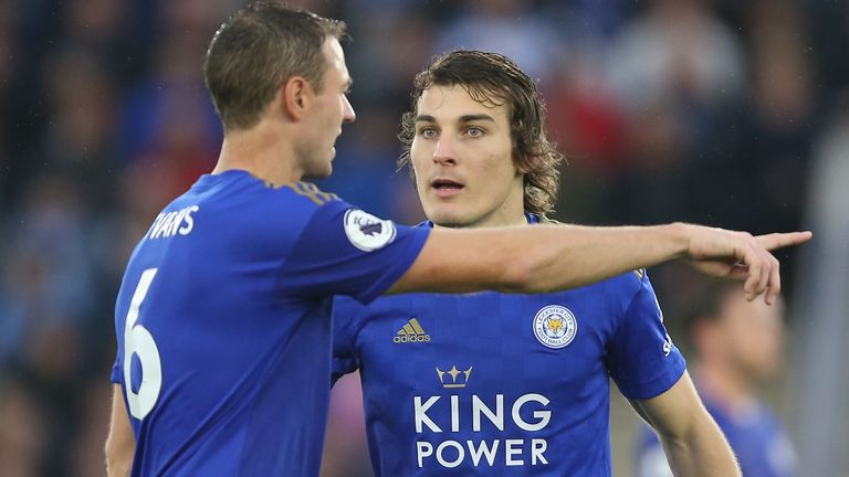 Jonny Evans gives instructions to Leicester team-mate Caglar Soyuncu