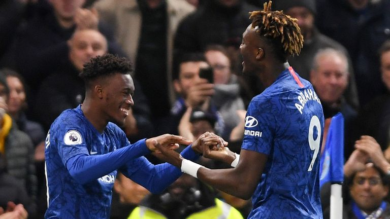 Callum Hudson-Odoi celebrates with team-mate Tammy Abraham after scoring Chelsea's third goal