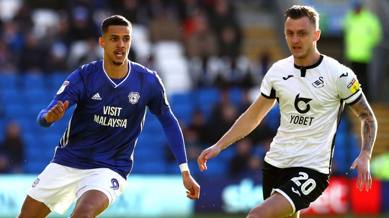 Cardiff's Robert Glatzel and Swansea's Ben Wilmot battle for possession