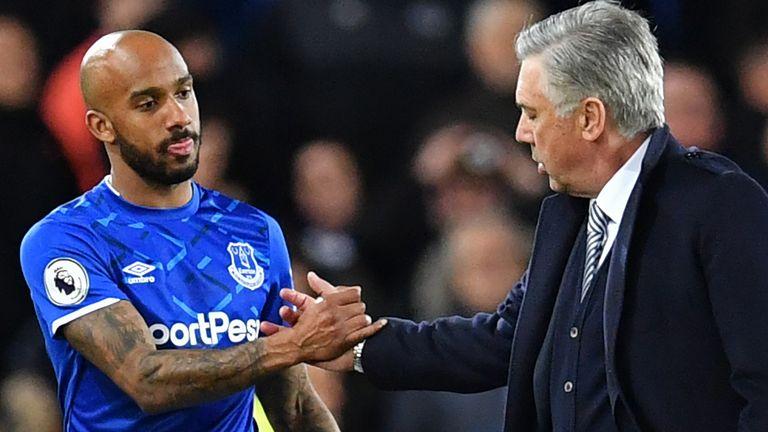 Everton boss Ancelotti shakes hands with midfielder Fabian Delph