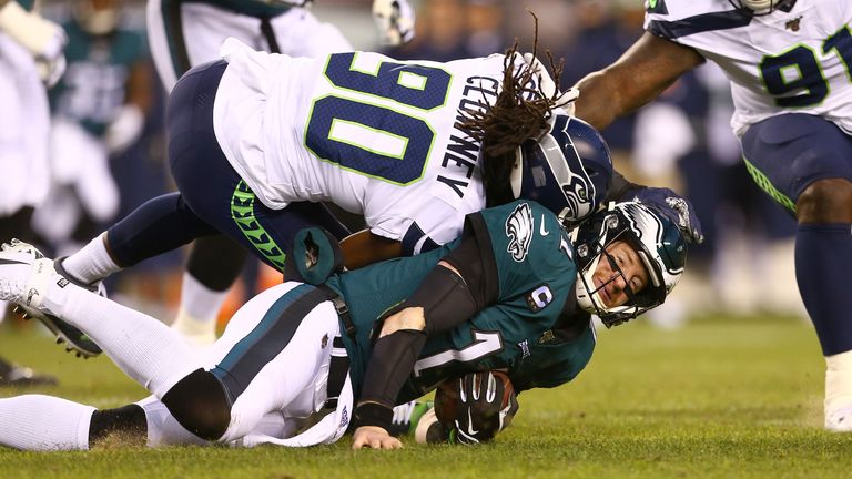 Carson Wentz was tackled to the turf by Jadeveon Clowney and knocked out of the game