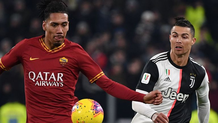 Roma's Chris Smalling and Juventus' Cristiano Ronaldo go for the ball during the Coppa Italia round of eight