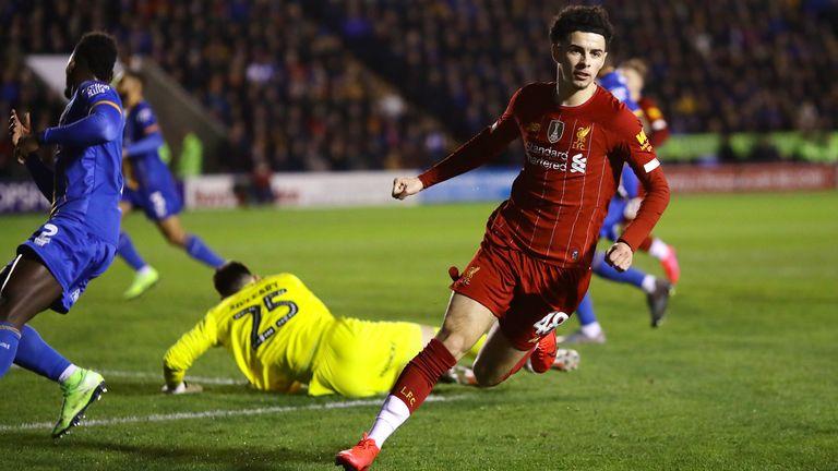 Curtis Jones wheels away after putting Liverpool ahead at Shrewsbury