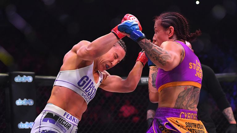 Julia Budd (red gloves) and Cris Cyborg (blue gloves) exchange blows during their featherweight world title fight at The Forum on January 25, 2020 in Inglewood, California. Cyborg won by TKO in the 4th round.