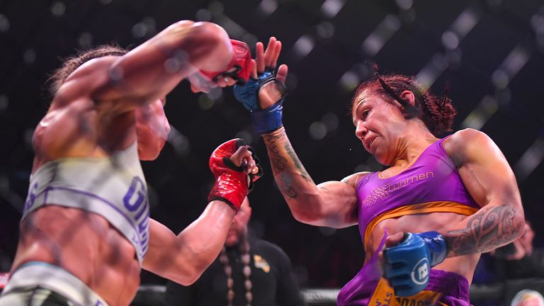 Julia Budd (red gloves) and Cris Cyborg (blue gloves) exchange blows during their featherweight world title fight at The Forum on January 25, 2020 in Inglewood, California. Cyborg won by TKO in the 4th round