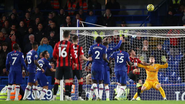 Bournemouth's Dan Gosling hooks the ball over the head of Chelsea goalkeeper Kepa Arrizabalaga