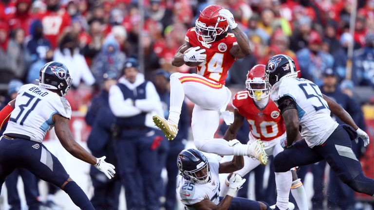 Darwin Thompson of the Kansas City Chiefs runs with the ball and jumps over Adoree' Jackson of the Tennessee Titans in the second half in the AFC Championship Game