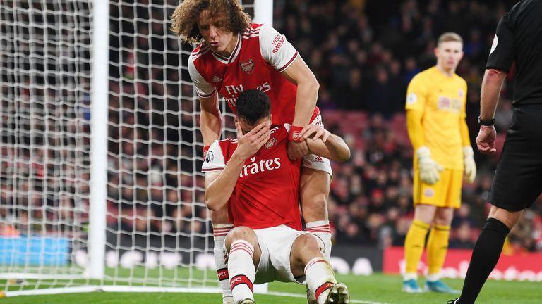 David Luiz drags Gabriel Martinelli to his feet against Sheffield United