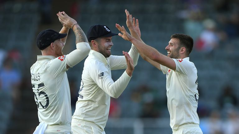 England bowler Mark Wood celebrates with Dom Sibley and Ben Stokes (l) after dismissing Anrich Nortje during Day Two of the Fourth Test between South Africa and England at Wanderers on January 25, 2020 in Johannesburg, South Africa.