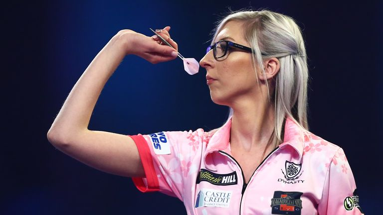 LONDON, ENGLAND - DECEMBER 27: Fallon Sherrock of England throws during her third round match against Chris Dobey of England on Day 12 of the 2020 William Hill World Darts Championship at Alexandra Palace on December 27, 2019 in London, England. (Photo by Jordan Mansfield/Getty Images)