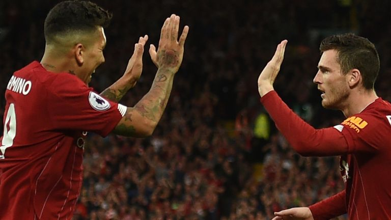 Roberto Firmino and Andy Robertson