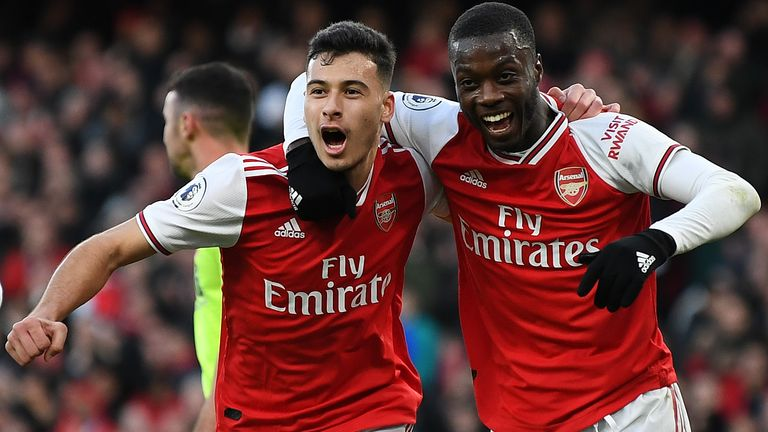 Arsenal goalscorer Gabriel Martinelli celebrates Nicolas Pepe