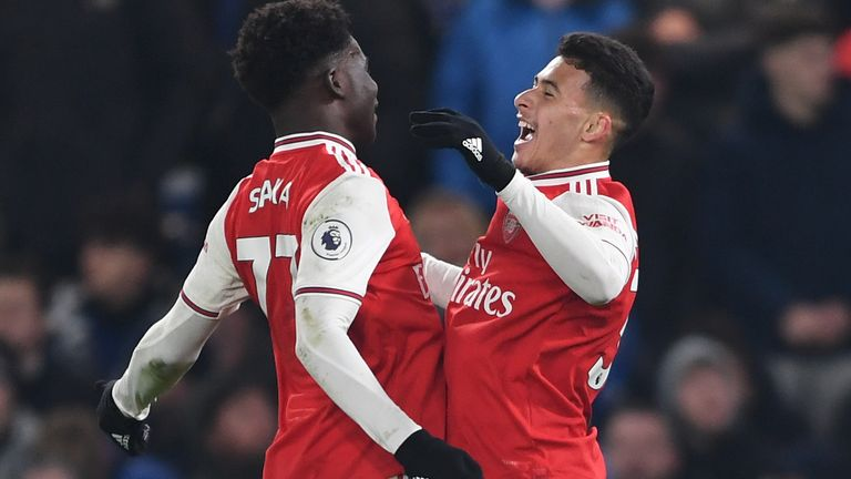 Gabriel Martinelli celebrates his goal with team-mate Bukayo Saka