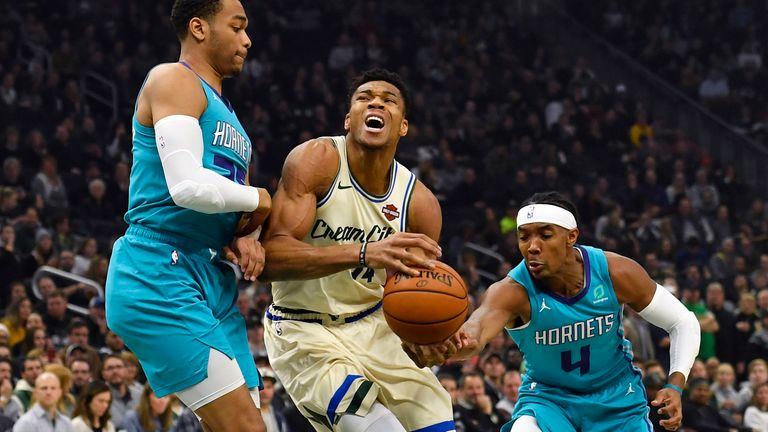 Giannis Antetokounmpo is fouled in the first half by Devonte' Graham