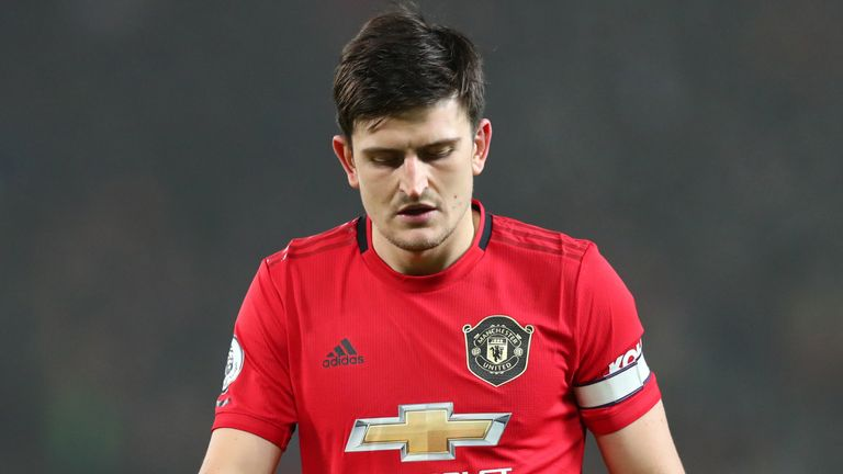 Harry Maguire walks off after the 2-0 loss to Burnley