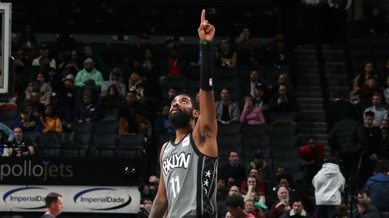 Kyrie Irving points to the heavens during the Brooklyn Nets game against the the Detroit Pistons