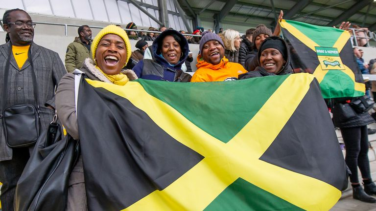 Jamaica fans cheering their team on against England Knights