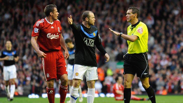 Wayne Rooney protests to Referee Andre Marriner after Michael Owen of Manchester United is brought down by Jamie Carragher of Liverpool during the Barclays Premier League match between Liverpool and Manchester United at Anfield on October 25, 2009 in Liverpool, England.